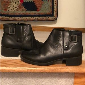 Black booties with buckle and side zip